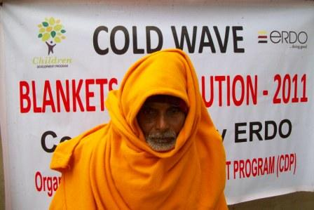 Bangladeshi cold-wave victim with a warm blanket provided by ERDO and our partner, Talitha Koumi
