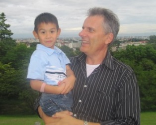 David Adcock, CEO of ERDO with his sponsored child, Montanna in Thailand