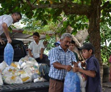 Delivering emergency food and water in the aftermath of extreme flooding in October 2011