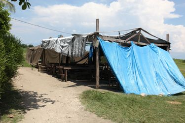 After the earthquake, makeshift housing used any available supplies