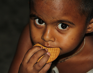 Bangladesh - In-school feeding program - eating a biscuit