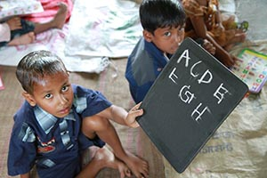Bangladesh - pre-school - showing off his English letters