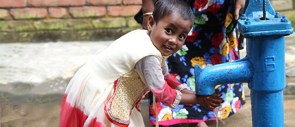 little girl in bangladesh with clean water