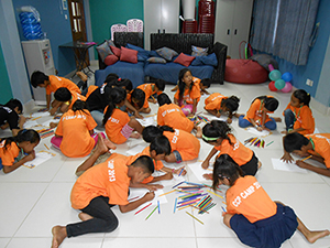 ChildCARE Plus Cambodia writing letters to their sponsors