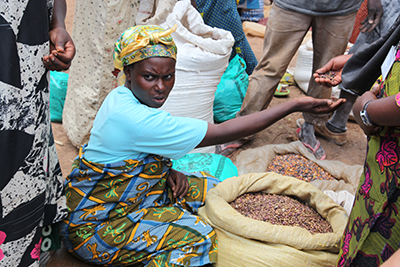 Congo-Microfinance borrower selling beans