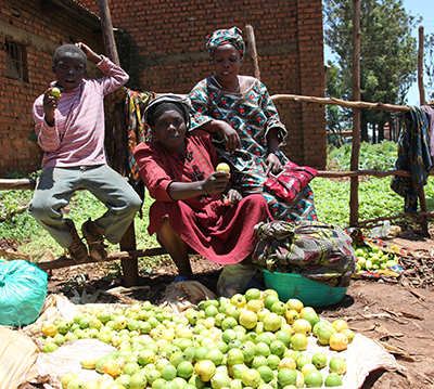 Congo-Microfinance borrower selling limes