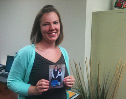Holding a photo of my sponsored child