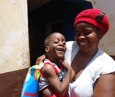 Child & worker from Malawi - Children of Blessing Trust