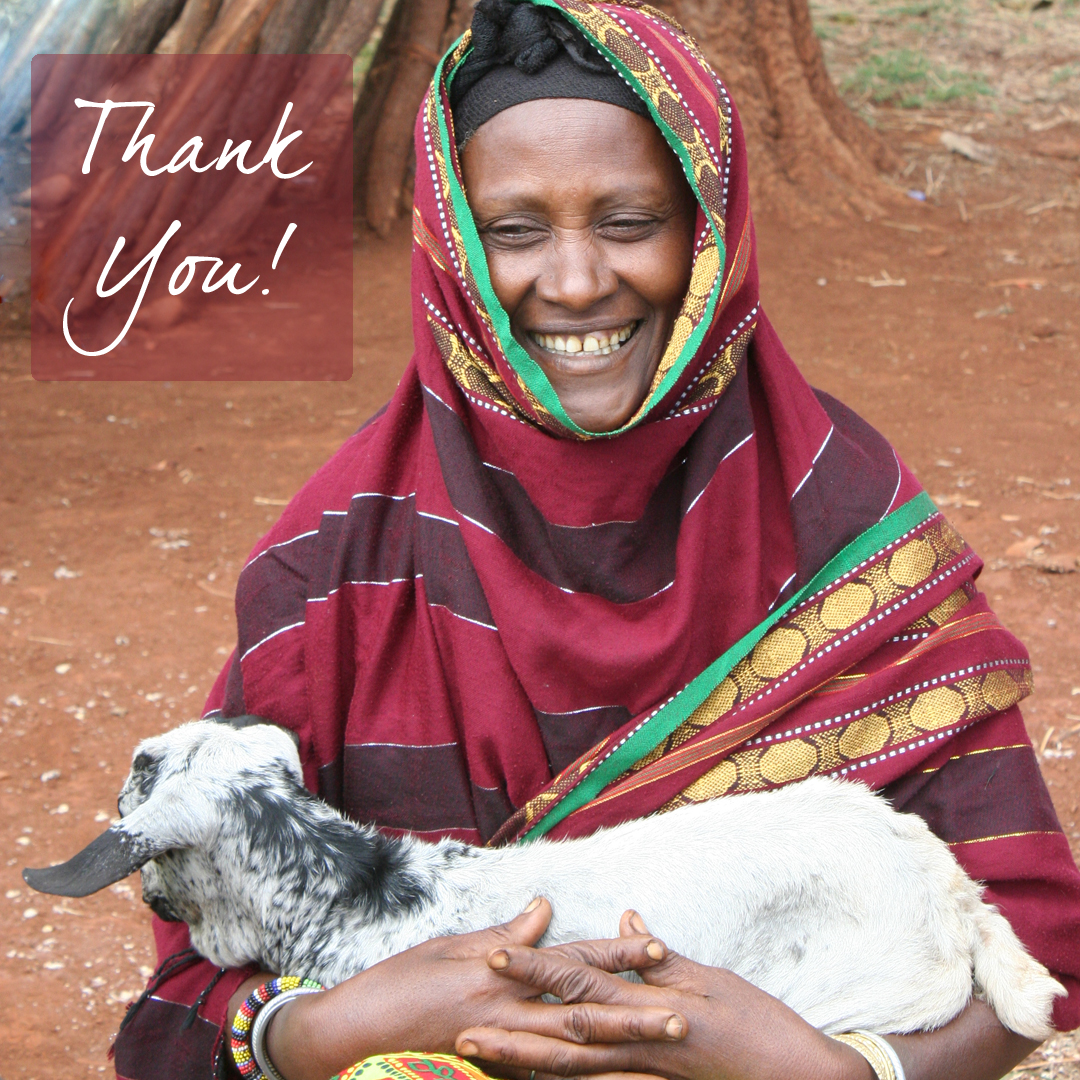 women in Kenya with a goat