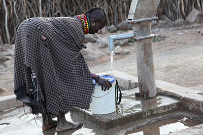 Woman gathering water at the well in Turkana, Kenya