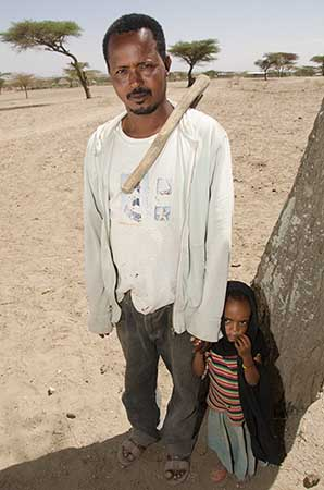 An Ethiopian farmer and his daughter
