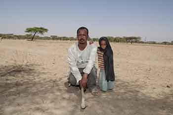 Ethiopian farmer and his daughter