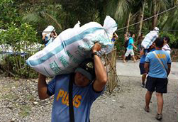Man Carrying Supplies for Philippines Typhoon Response