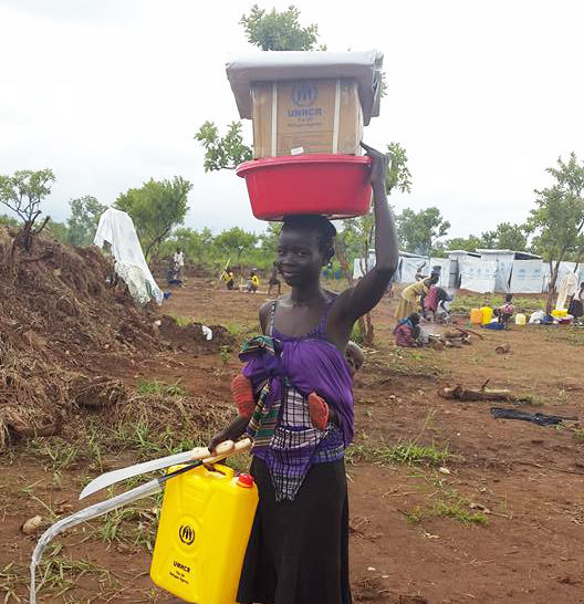 mother getting relief items in south sudan