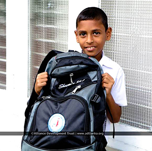 boy smiling with backpack