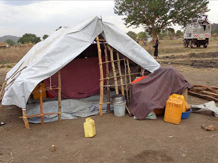 Temporary shelter in Uganda at the camp for Sudanese refugees