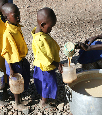 Children receiving food at the feeding program in Kenya