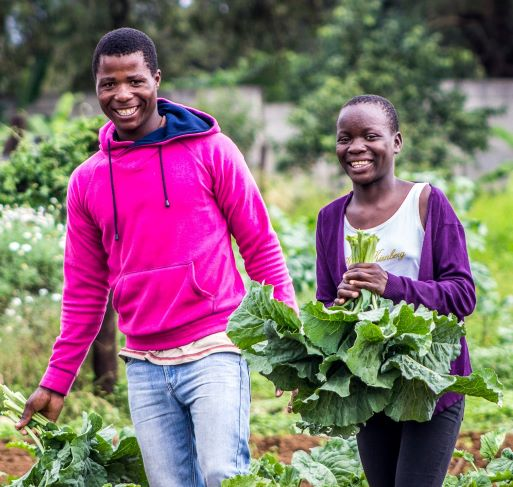 Young people holding farm produce