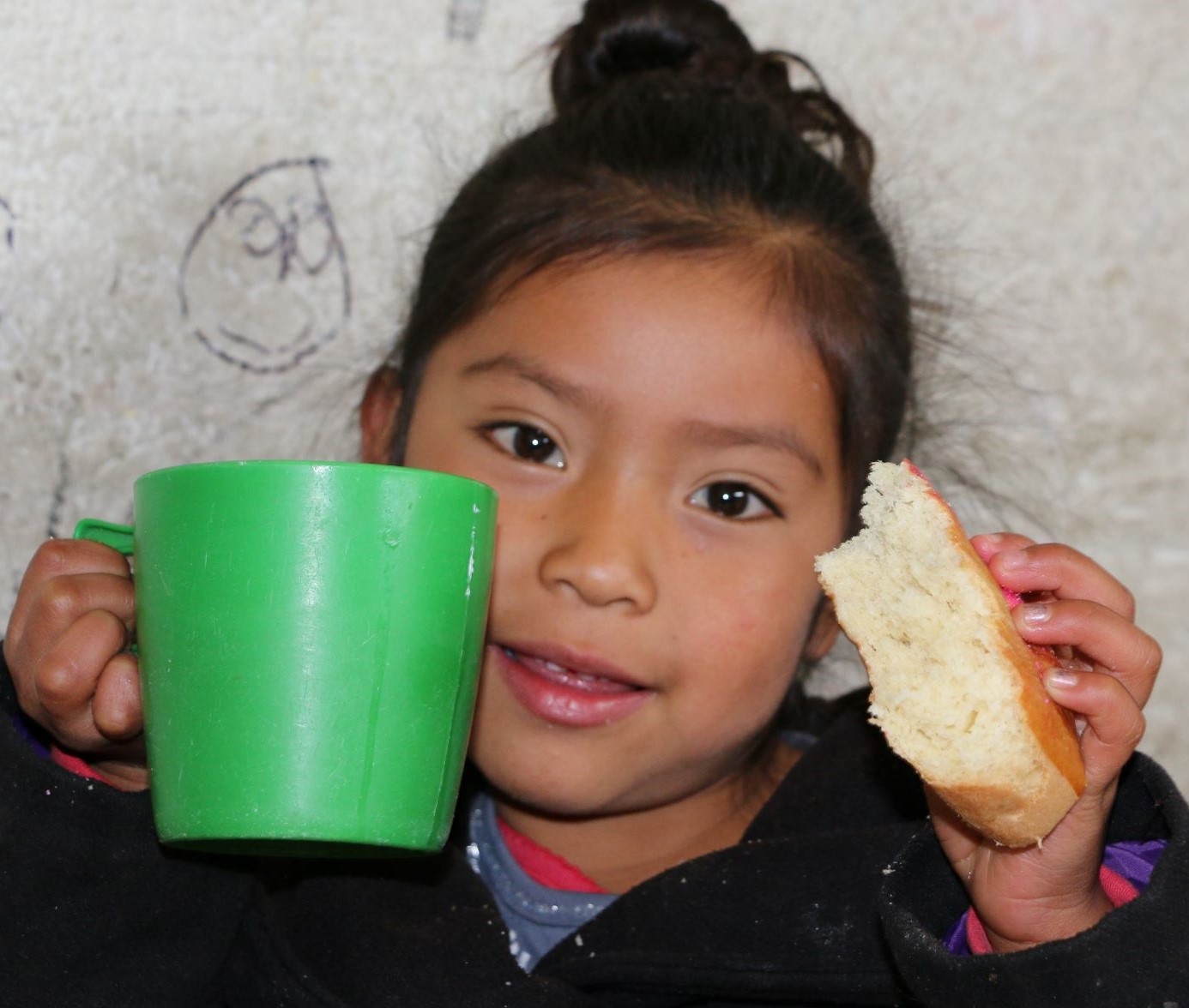Honduran child with water and bread