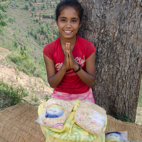 litle girl with family food relief packs