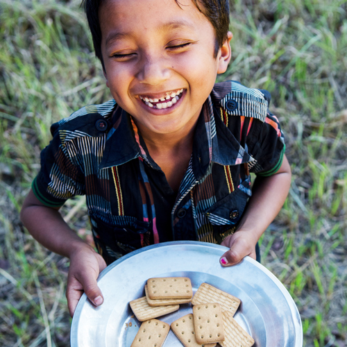 little boy with cookies smiling