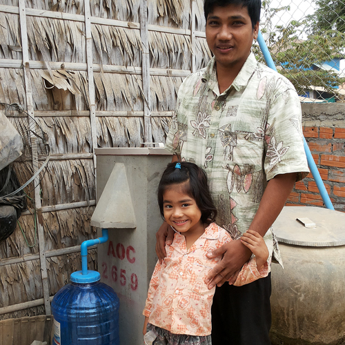 bio sand filter little girl and daddy