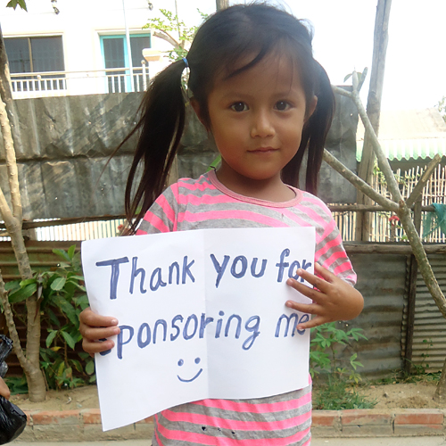 child from cambodia thanking sponsor