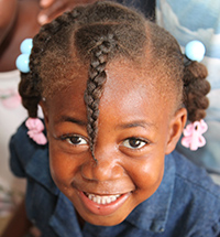 A child who attends the Haiti feeding program