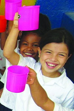 little girls in school honduras feeding program