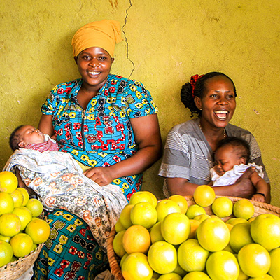 smiling women with babies