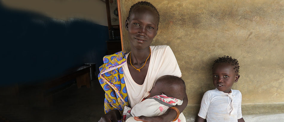 woman in kenya with two children