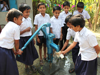 Bangladesh - Children gather at the well