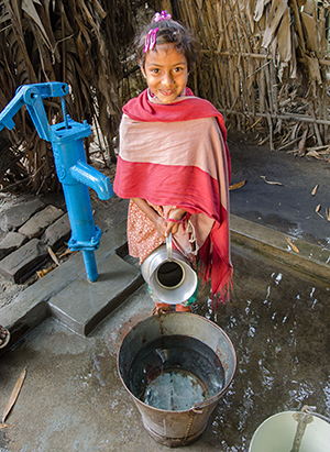 little girl in bangladesh at tube well