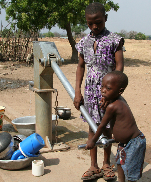 Little boy at well in Ghana LJAW project