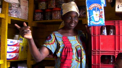 This is Mama Uzima a loan borrower with 9 children who is able to run a store because of her loan.