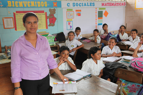 Teacher and students in a classroom in Honduras