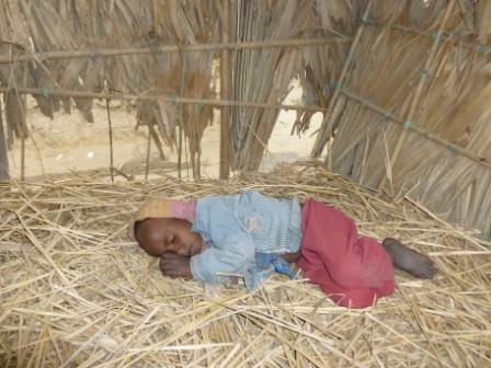 A child tries to sleep during the coldest January in 45 years in Bangladesh