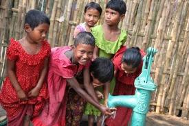 Children in Bangladesh enjoying fresh, clean water.