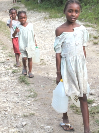 Girls gathering water - with a new well in their community they won't need to travel so far